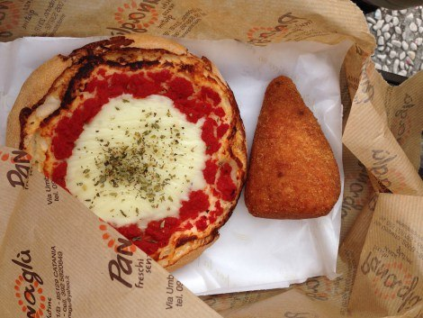 Mini pizza and arancino – a rice ball filled with sauce and cheese from Panaglu in Catania