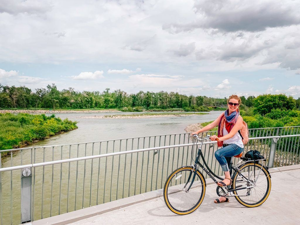Riding a bike along the Bow River in Calgary