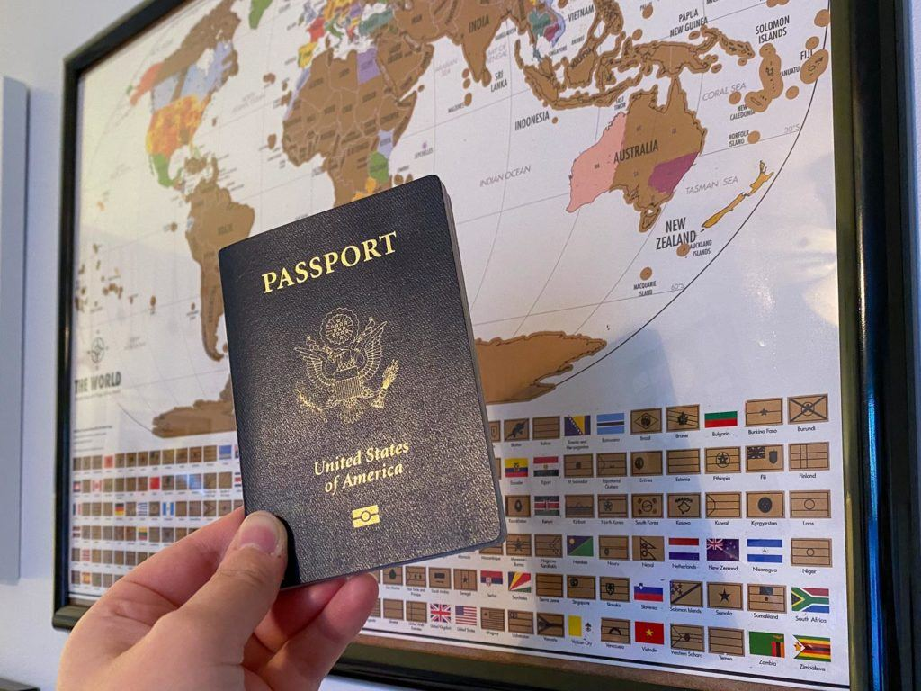 Passport in front of a map