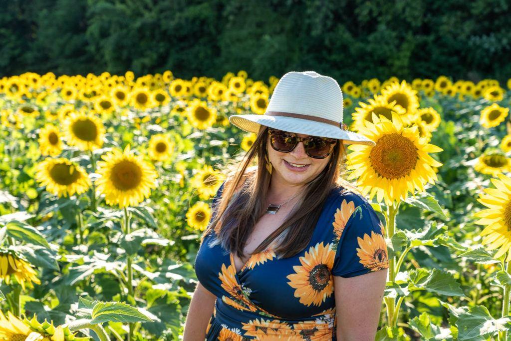 Amanda in a sunflower field